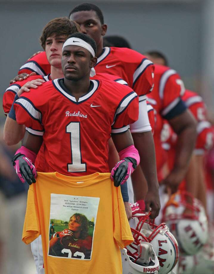 "Before a high school football game against Lamar, and during the playing of the National Anthem, Cedric Lancaster holds a t-shirt paying tribute to teammate Jack ""Sunshine"" Williams who died of a self-inflicted gunshot wound February 14, Saturday, October 13, 2012 at Delmar Stadium in Houston, TX. Photo: Eric Christian Smith, For The Chronicle"