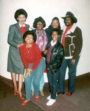 Kevin Ollie poses with members of his family in a photograph taken when he was in the sixth-grade. Photo: Contributed Photo