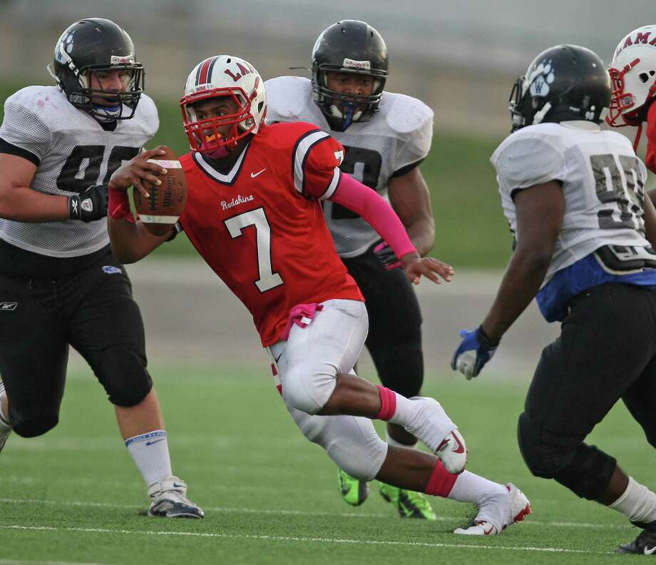 Lamar quarterback Darrell Colbert (7) runs the ball upfield past the Westfield  defenseduring the first half of a high school football game, Saturday, October 13, 2012 at Delmar Stadium in Houston, TX. Photo: Eric Christian Smith, For The Chronicle