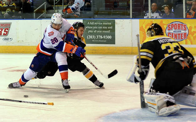 Sound Tigers Johan Sundstrom gets tangled up with Providence's #17 Chris Bourque as Sundtrom tries to get to the goal with the puck, during hockey action at the Webster Bank Arena in Bridgeport, Conn. on Friday October 13, 2012. Photo: Christian Abraham / Connecticut Post
