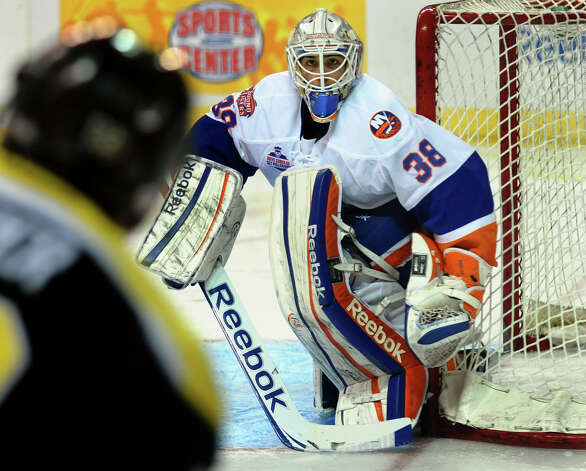 Sound Tigers goalie Kevin Poulin tracks a Providence player, during home opener hockey action at the Webster Bank Arena in Bridgeport, Conn. on Friday October 13, 2012. Photo: Christian Abraham / Connecticut Post