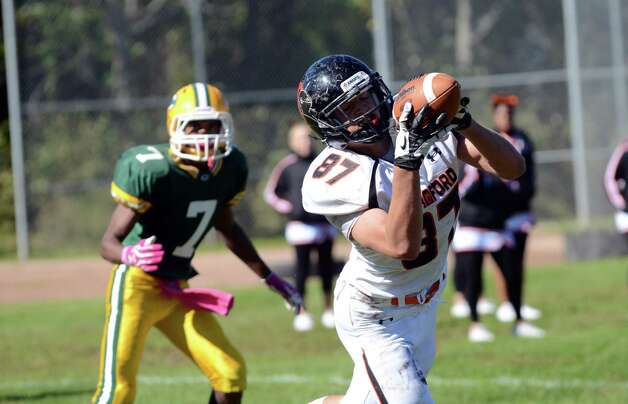 Stamford's Jack Rakoczy (87) hauls in a pass for a touchdown during the football game against Trinity at Trinity Catholic High School in Stamford on Saturday, Oct. 13, 2012. Photo: Amy Mortensen / Connecticut Post Freelance