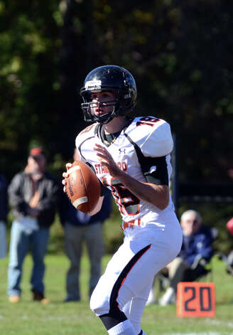 Stamford's Tyler Kane (18) looks to pass during the football game against Trinity at Trinity Catholic High School in Stamford on Saturday, Oct. 13, 2012. Photo: Amy Mortensen / Connecticut Post Freelance