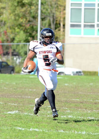 Stamford's Cameron Webb (5) carries the ball during the football game against Trinity at Trinity Catholic High School in Stamford on Saturday, Oct. 13, 2012. Photo: Amy Mortensen / Connecticut Post Freelance