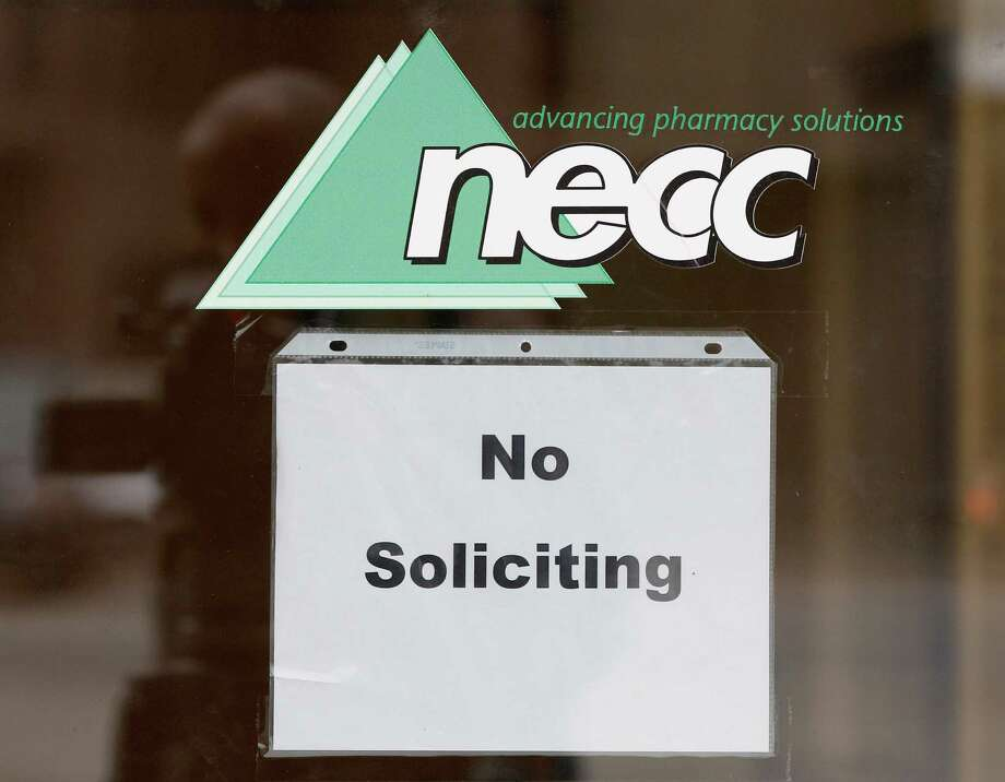 """FILE - In this Oct. 4, 2012 file photo, a sign requesting """"No Soliciting"""" hangs on the door of New England Compounding in Framingham, Mass. The New England Compounding Center and its practices are under scrutiny as investigators try to determine how a steroid solution supplied by the pharmacy apparently became contaminated with a fungus. The drug has sickened more than 180 people in 12 states, killing 14. Most of the patients had received spinal injections of the steroid for back pain. (AP Photo/Stephan Savoia) Photo: Stephan Savoia / AP"""