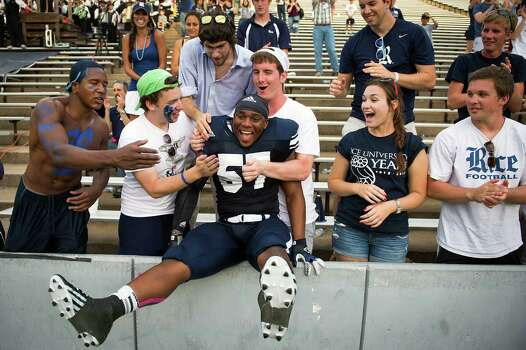 Rice linebacker Cameron Nwosu celebrates with fans in the student section following the Owls' 34-14 victory over Texas-San Antonio during in a college football game at Rice Stadium, Saturday, Oct. 13, 2012, in Houston. Photo: Smiley N. Pool, Houston Chronicle / © 2012  Houston Chronicle