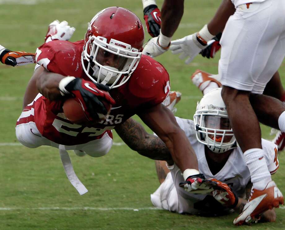 Oklahoma Sooners running back Brennan Clay (24) tries to stretch for the goal line, but falls short of a touchdown, in the fourth quarter of the Red River Rivalry against the Texas Longhorns at the Cotton Bowl in Dallas, Texas, Saturday, October 13, 2012. Oklahoma beat Texas 63-21. (Richard W. Rodriguez/Fort Worth Star-Telegram/MCT) Photo: Richard W. Rodriguez, McClatchy-Tribune News Service / Fort Worth Star-Telegram
