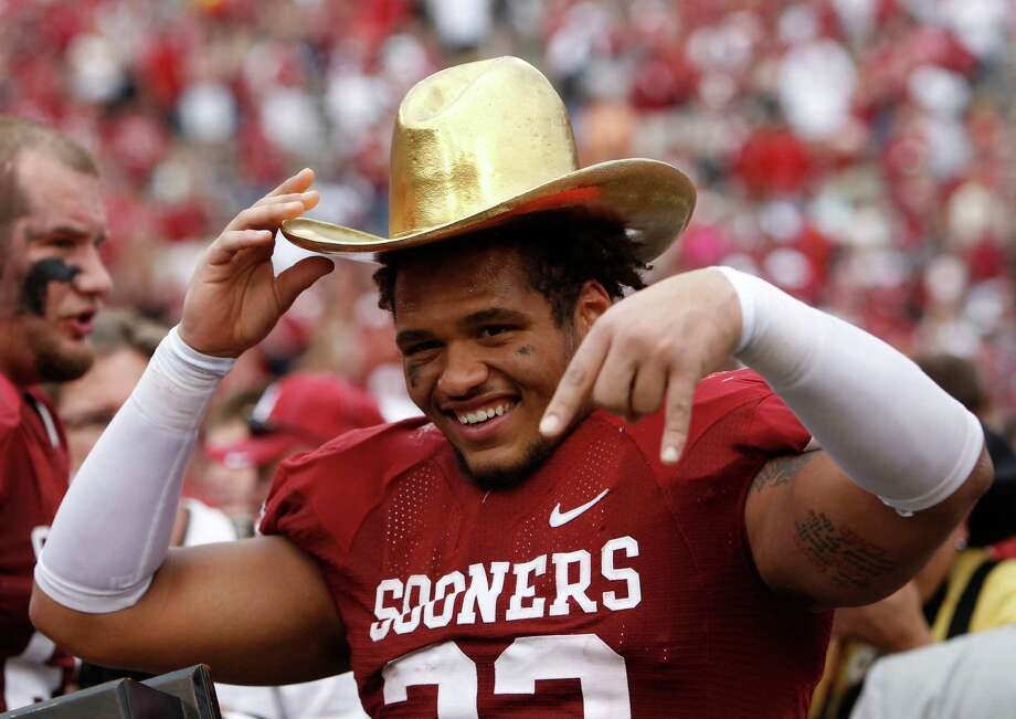 Oklahoma Sooners fullback Trey Millard (33) wears the golden hat trophy after the Red River Rivalry against the Texas Longhorns at the Cotton Bowl in Dallas, Texas, Saturday, October 13, 2012. Oklahoma beat Texas 63-21. (Richard W. Rodriguez/Fort Worth Star-Telegram/MCT) Photo: Richard W. Rodriguez, McClatchy-Tribune News Service / Fort Worth Star-Telegram
