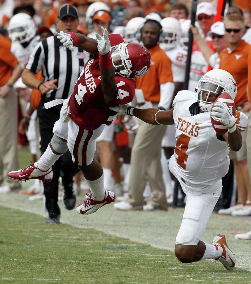 Oklahoma Sooners defensive back Aaron Colvin (14) breaks up a pass intended for Texas Longhorns wide receiver Cayleb Jones (4) in the third quarter of the Red River Rivalry at the Cotton Bowl in Dallas, Texas, Saturday, October 13, 2012. Oklahoma beat Texas 63-21. (Richard W. Rodriguez/Fort Worth Star-Telegram/MCT) Photo: Richard W. Rodriguez, McClatchy-Tribune News Service / Fort Worth Star-Telegram