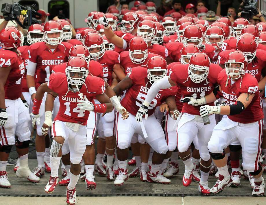 Oklahoma  takes the field before the NCAA college football game against Texas at the Cotton Bowl Saturday, Oct. 13, 2012, in Dallas. (AP Photo/LM Otero) Photo: LM Otero, Associated Press / AP