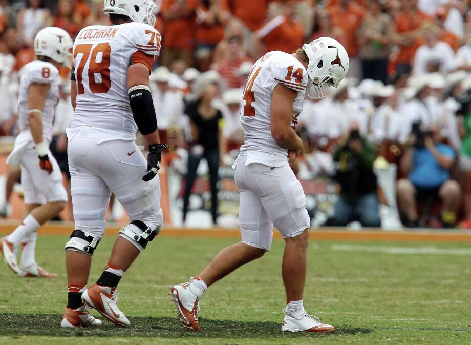 Injury was added to the insult of a lopsided loss as UT's David Ash left with a banged-up wrist. Photo: Kin Man Hui / © 2012 San Antonio Express-News
