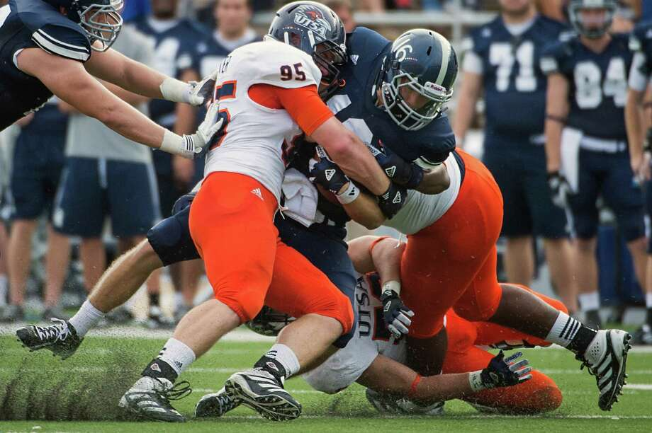 Rice quarterback Taylor McHargue (16) is brought down by UTSA defensive end Dan Winter (95) and linebacker Brandon Reeves during the fourth quarter of a college football game at Rice Stadium, Saturday, Oct. 13, 2012, in Houston. Photo: Smiley N. Pool, Houston Chronicle / © 2012  Houston Chronicle