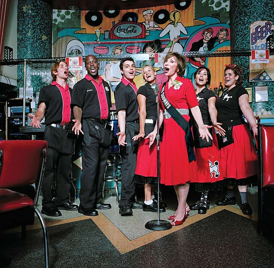 Ellen Hart Sturm, a Miss Subway from 1959, sings at her Ellen's Stardust Diner in New York. Photo: Fiona Gardner, Associated Press