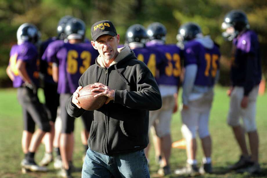 Coach Ken Meyer, center, leads his combined varsity football team during practice on Friday, Oct. 12, 2012, at Schoharie High in Schoharie, N.Y. (Cindy Schultz / Times Union) Photo: Cindy Schultz / 00019603A