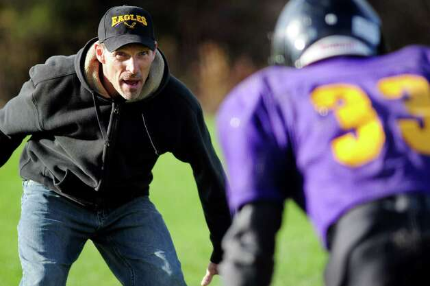 Coach Ken Meyer, left, works with his combined varsity football team during practice on Friday, Oct. 12, 2012, at Schoharie High in Schoharie, N.Y. (Cindy Schultz / Times Union) Photo: Cindy Schultz / 00019603A