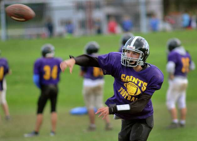 Quarterback Sean McGarry of Duanesburg throws the ball during the combined varsity football team practice on Friday, Oct. 12, 2012, at Schoharie High in Schoharie, N.Y. (Cindy Schultz / Times Union) Photo: Cindy Schultz / 00019603A