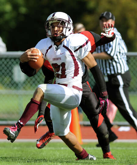 Lansingburgh's Anthony Walker (21) gains yards during their football game against Albany Academy on