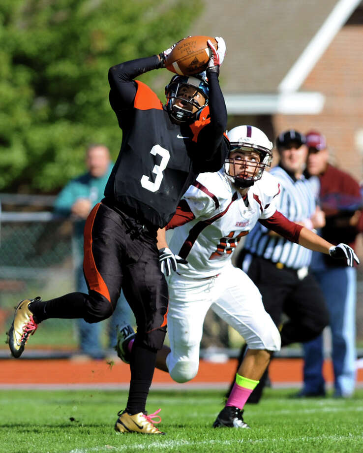 Albany Academy's Darrien White (3), left, catches a pass as Lansingburgh's Connor Zanda (10) defends during their football game on Saturday, Oct. 13, 2012, at Albany Academy in Albany, N.Y. (Cindy Schultz / Times Union) Photo: Cindy Schultz