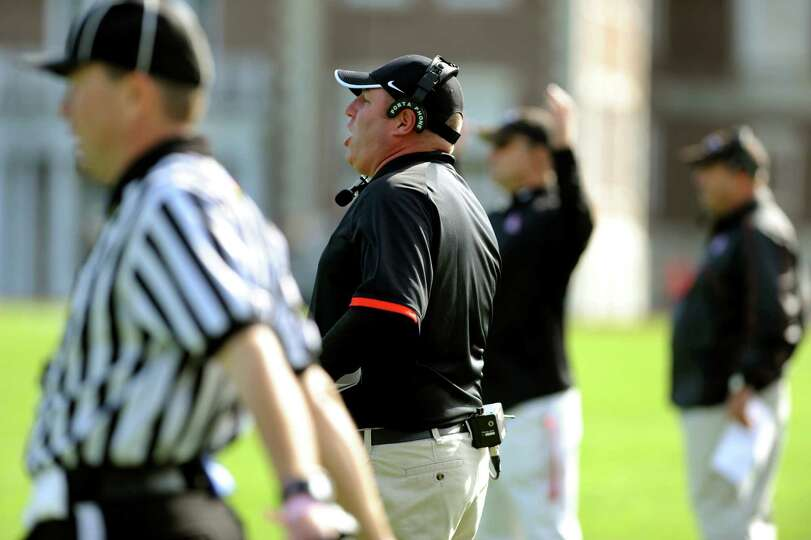 Albany Academy's coach Tony Fruscio, center, disagrees with an official's call during their football