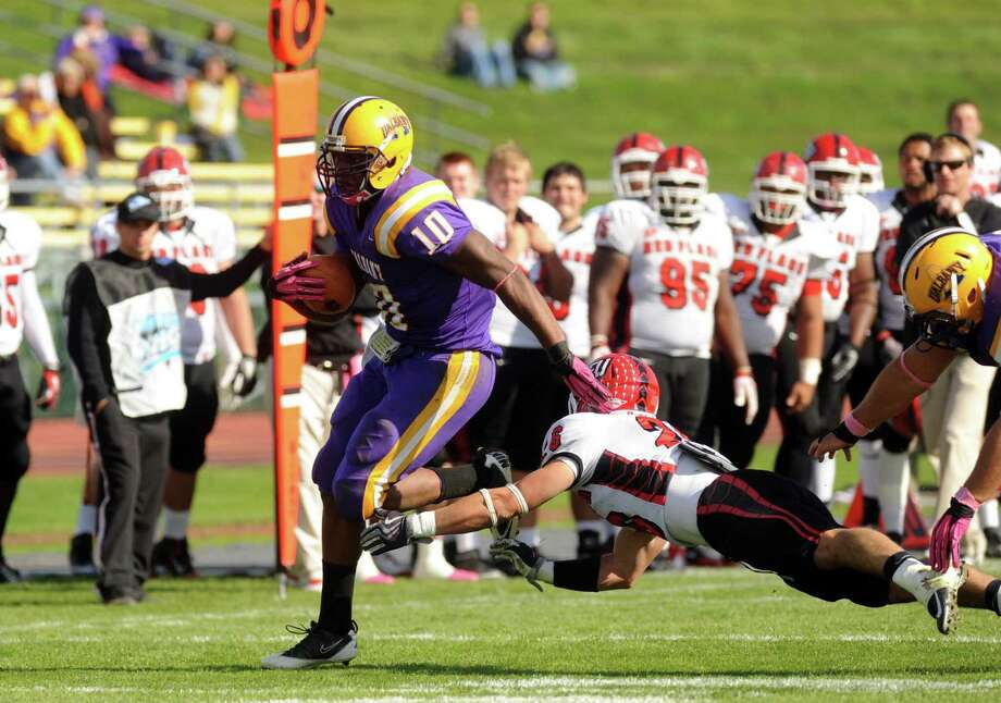 UAlbany's Drew Smith runs for a gain during their college football game against St. Francis in Albany, NY Saturday Oct. 13, 2012. (Michael P. Farrell/Times Union) Photo: Michael P. Farrell