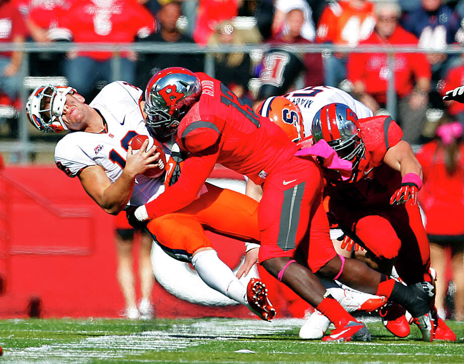 PISCATAWAY, NJ - OCTOBER 13: Quarterback Ryan Nassib #12 of the Syracuse Orange is hit hard by Ka'Lial Glaud #13 of the Rutgers Scarlet Knights during the second half in a game at High Point Solutions Stadium on October 13, 2012 in Piscataway, New Jersey. Rutgers defeated Syracuse 23-15. (Photo by Rich Schultz/Getty Images) Photo: Rich Schultz