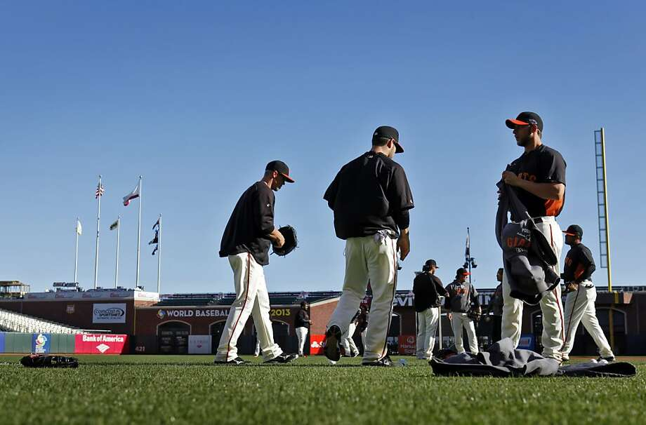 The Giants players take to the field Saturday for some practice on Saturday. The San Francisco Giants and the St. Louis Cardinals practiced on Saturday, October 13, 2012, at AT&T Park in San Francisco, Calif., the day before the start of the National League Championship Series. Photo: Carlos Avila Gonzalez, The Chronicle