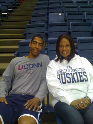 University of Connecticut basketball coach Kevin Ollie with his mother Dorothy Ollie in Storrs, Conn. recently. Photo: Contributed Photo / Connecticut Post Contributed