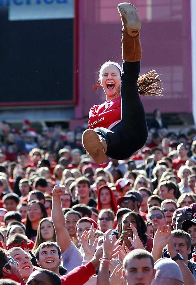 A fan is tossed in the air after a Rutgers touchdown during the first half of an NCAA college football game against Syracuse at High Points Solutions Stadium in Piscataway, N.J., Saturday, Oct. 13, 2012. Rutgers won 23- 15. (AP Photo/Mel Evans) Photo: Mel Evans, Associated Press