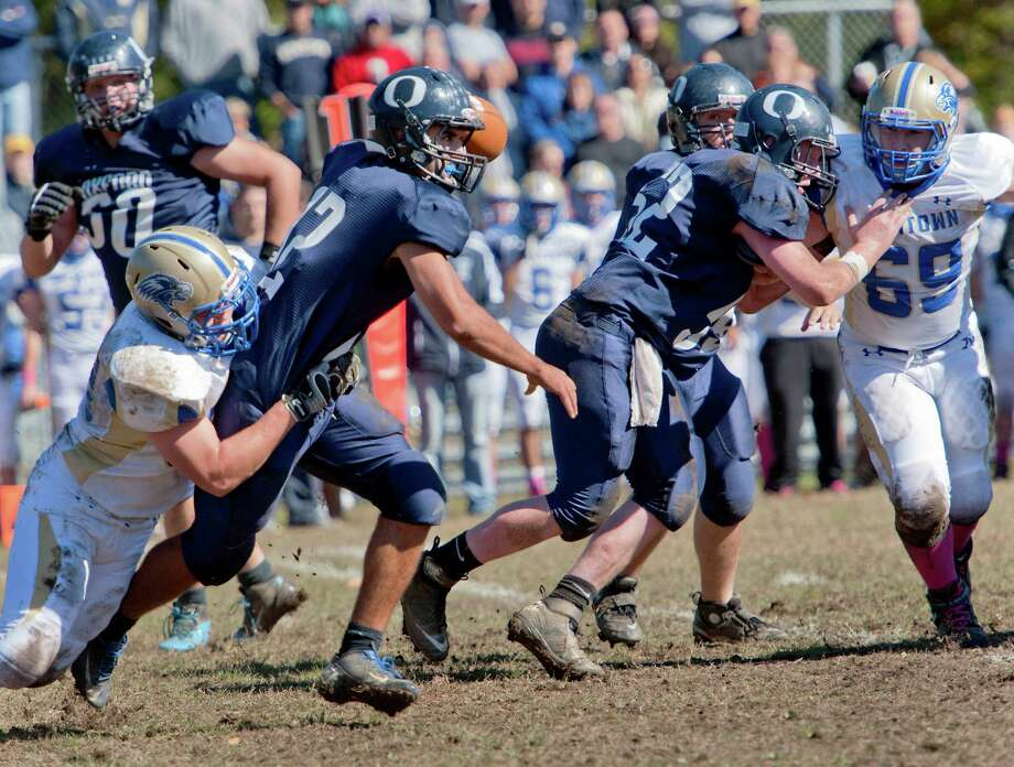Newtown high school's Pat Thornberg sacks Oxford high school quarterback Brennen Diaz in a football game held at Oxford high School, Oxford, CT on Saturday October 13th, 2012. Photo: Mark Conrad / Connecticut Post Freelance