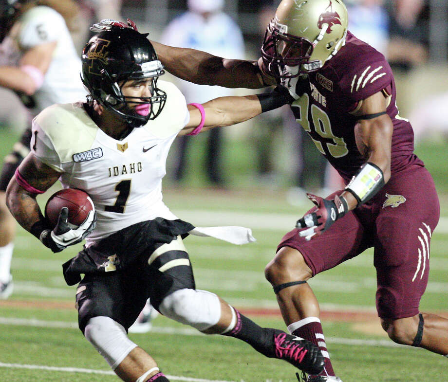 Idaho Vandals' Justin Veltung tries to shake the tackle of Texas State Bobcats' Denzel Wells on a punt return during second half action Saturday Oct. 13, 2012 at Bobcat Stadium in San Marcos, Tx. Texas State won 38-7. Photo: Edward A. Ornelas, Express-News / © 2012 San Antonio Express-News