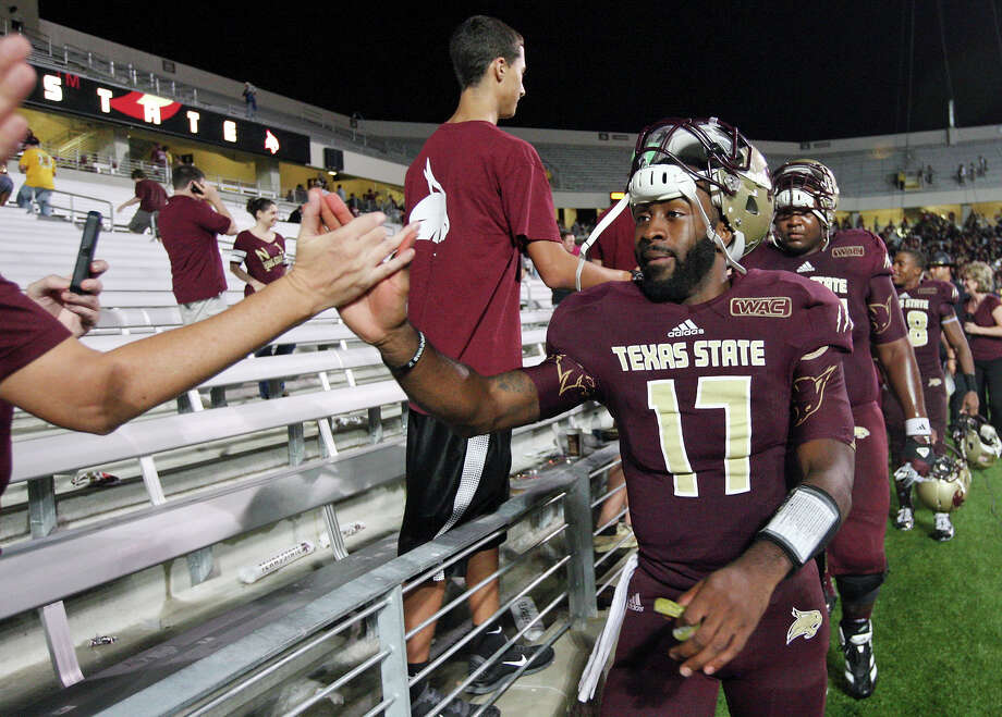 Texas State Bobcats' Shaun Rutherford glad-hands fans after the game with the Idaho Vandals Saturday Oct. 13, 2012 at Bobcat Stadium in San Marcos, Tx. Texas State won 38-7. Photo: Edward A. Ornelas, Express-News / © 2012 San Antonio Express-News