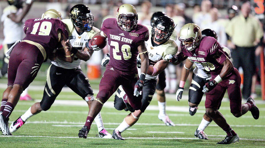 Texas State Bobcats' Terrence Franks (center) heads up field against the Idaho Vandals during second half action Saturday Oct. 13, 2012 at Bobcat Stadium in San Marcos, Tx. Texas State won 38-7. Photo: Edward A. Ornelas, Express-News / © 2012 San Antonio Express-News