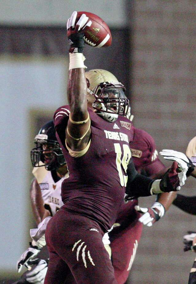 Texas State Bobcats' Chase Harper makes a one handed catch during first half action against the Idaho Vandals Saturday Oct. 13, 2012 at Bobcat Stadium in San Marcos, Tx. Photo: Edward A. Ornelas, Express-News / © 2012 San Antonio Express-News