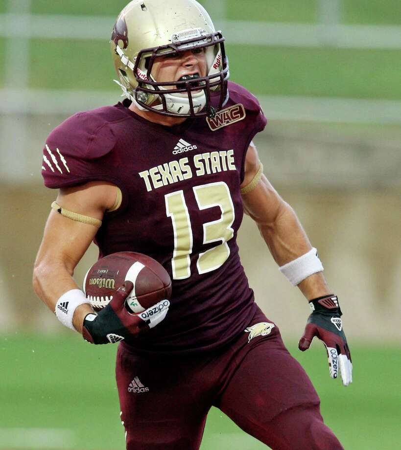 Texas State Bobcats' Andy Erickson celebrates as he scores a touchdown against the Idaho Vandals during first half action Saturday Oct. 13, 2012 at Bobcat Stadium in San Marcos, Tx. Photo: Edward A. Ornelas, Express-News / © 2012 San Antonio Express-News