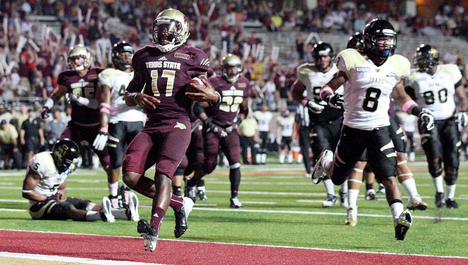 Texas State Bobcats' Shaun Rutherford scores a touchdown during first half action against the Idaho Vandals Saturday Oct. 13, 2012 at Bobcat Stadium in San Marcos, Tx. Photo: Edward A. Ornelas, Express-News / © 2012 San Antonio Express-News