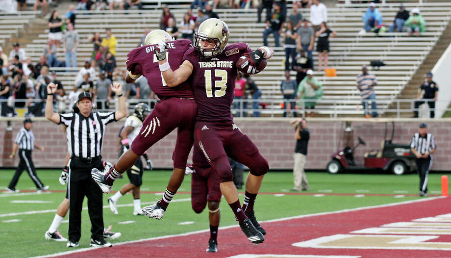 Texas State Bobcats' Michael Gilmore (left) celebrates with teammate Texas State Bobcats' Andy Erickson after he scored a touchdown during first half action against the Idaho Vandals Saturday Oct. 13, 2012 at Bobcat Stadium in San Marcos, Tx. Photo: Edward A. Ornelas, Express-News / © 2012 San Antonio Express-News