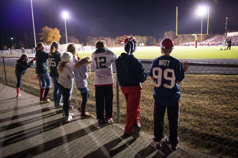When J.J. Watts was a kid growing up Pewaukee, Wis., he idolized the high school quarterback, thinking he was even greater than Brett Favre. Now, Pewaukee youngsters like 11-year-old Luke Lochner wear the No. 99 Texans jersey to the homecoming football game of Watt's alma mater. Photo: Smiley N. Pool / © 2012  Houston Chronicle