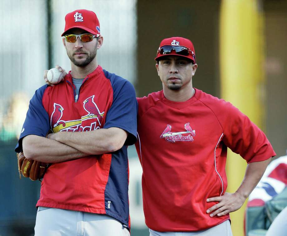 St. Louis Cardinals' Adam Wainwright, left, and Kyle Lohse chat during a practice session for baseball's National League championship series Saturday, Oct. 13, 2012, in San Francisco. The Cardinals play the San Francisco Giants in Game 1 of the NLCS on Sunday. (AP Photo/David J. Phillip) Photo: David J. Phillip