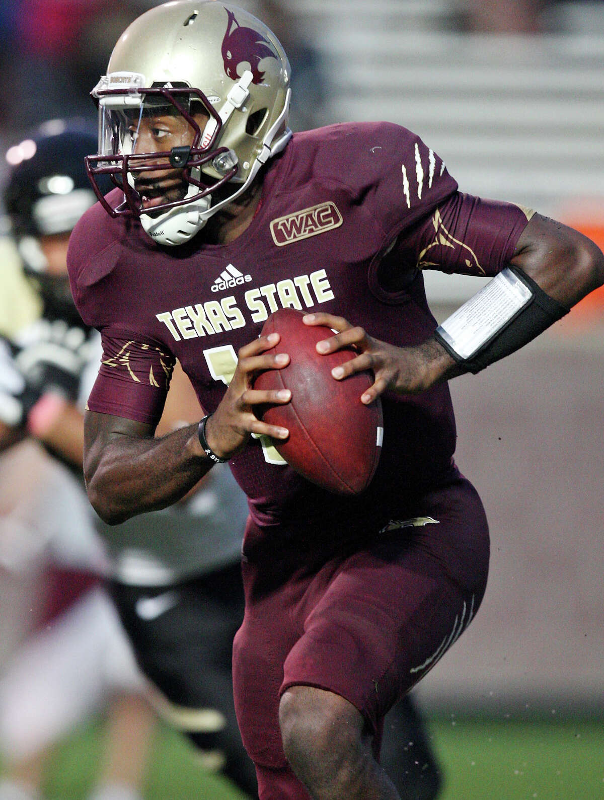 Texas State Bobcats' Shaun Rutherford looks for running room against the Idaho Vandals during first half action Saturday Oct. 13, 2012 at Bobcat Stadium in San Marcos, Tx.