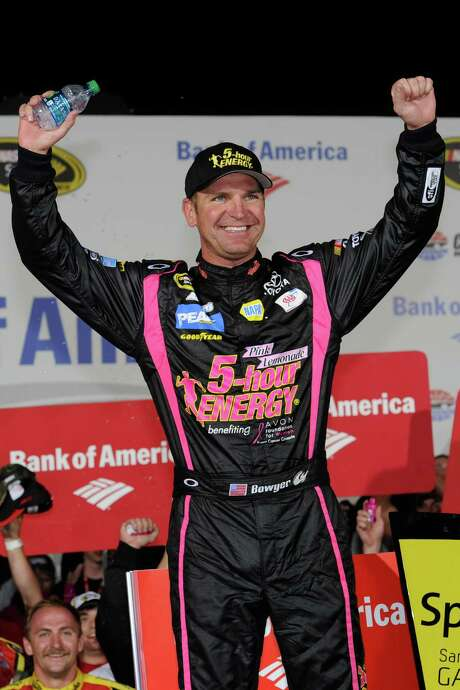 It's V for victory as Clint Bowyer celebrates winning Saturday's Sprint Cup race in Concord, N.C. Photo: John Harrelson / 2012 Getty Images