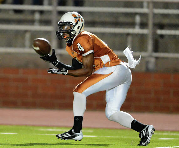 Madison's Byron Daniels (4) hauls in a pass during a 26-5A Football game between the Reagan Rattlers and the Madison Mavericks at Heroes Stadium in San Antonio, Saturday, October 13, 2012.