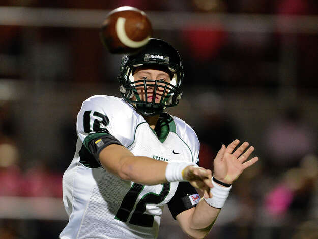 Reagan's Kyle Keller (12) throws a screen pass  during a 26-5A Football game between the Reagan Rattlers and the Madison Mavericks at Heroes Stadium in San Antonio, Saturday, October 13, 2012.