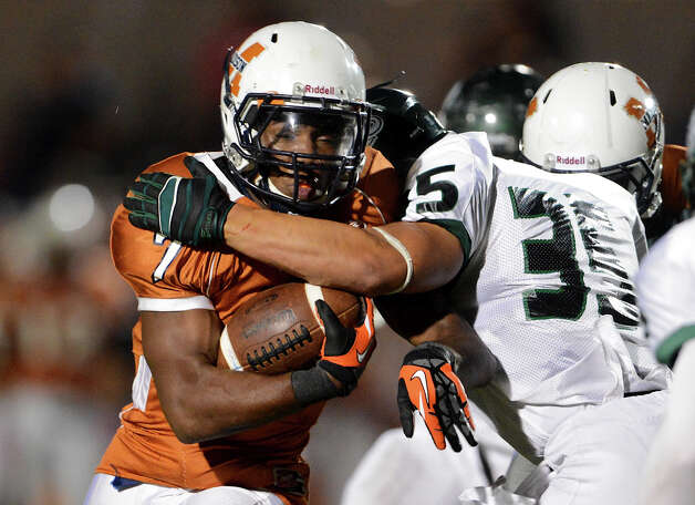 Madison's Marques Warford (7) is hit by Reagan's Paco Dickinson (35) during a 26-5A Football game between the Reagan Rattlers and the Madison Mavericks at Heroes Stadium in San Antonio, Saturday, October 13, 2012.
