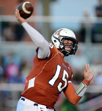 Madison quarterback Cody Ennis (15) throws a pass during a 26-5A Football game between the Reagan Rattlers and the Madison Mavericks at Heroes Stadium in San Antonio, Saturday, October 13, 2012.