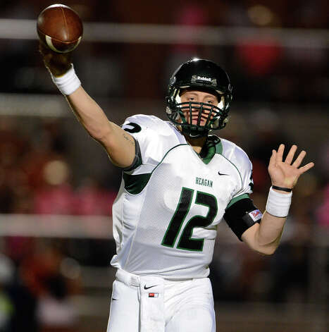 Reagan's Kyle Keller (12) throws a pass during a 26-5A Football game between the Reagan Rattlers and the Madison Mavericks at Heroes Stadium in San Antonio, Saturday, October 13, 2012.