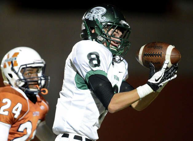 Reagan's Zach Morrow (8) hauls in a touchdown pass during a 26-5A Football game between the Reagan Rattlers and the Madison Mavericks at Heroes Stadium in San Antonio, Saturday, October 13, 2012.