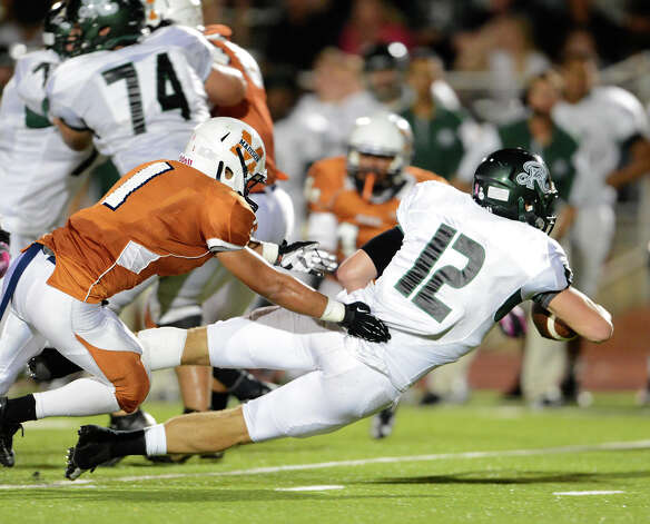 Reagan's Kyle Keller (12) dives for yardage during a 26-5A Football game between the Reagan Rattlers and the Madison Mavericks at Heroes Stadium in San Antonio, Saturday, October 13, 2012.
