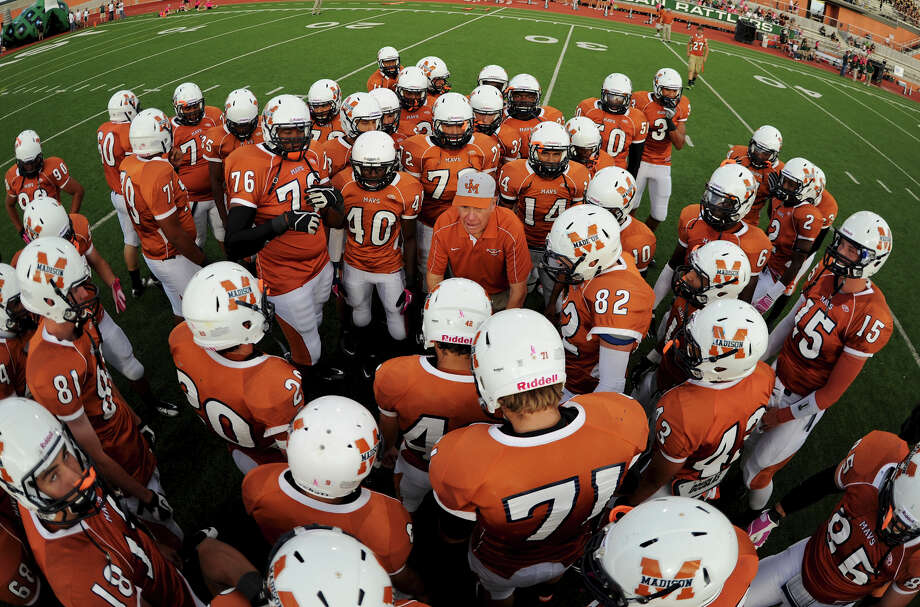 The Madison Mavericks gather around head coach Jim Streety before a 26-5A Football  game between the Reagan Rattlers and the Madison Mavericks at Heroes Stadium in San Antonio, Saturday, October 13, 2012. John Albright / Special to the Express-News. Photo: JOHN ALBRIGHT, Express-News / San Antonio Express-News