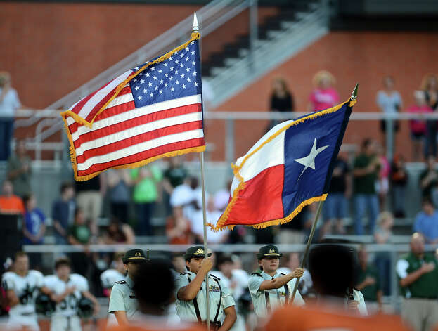 Reagan's ROTC presents the colors before a 26-5A Football game between the Reagan Rattlers and the Madison Mavericks at Heroes Stadium in San Antonio, Saturday, October 13, 2012.