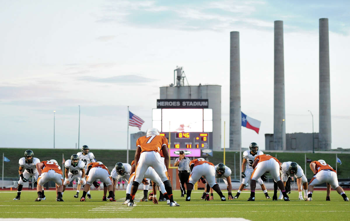The old Longhorn Quarry serves a backdrop during a 26-5A Football game between the Reagan Rattlers and the Madison Mavericks at Heroes Stadium in San Antonio, Saturday, October 13, 2012. John Albright / Special to the Express-News.